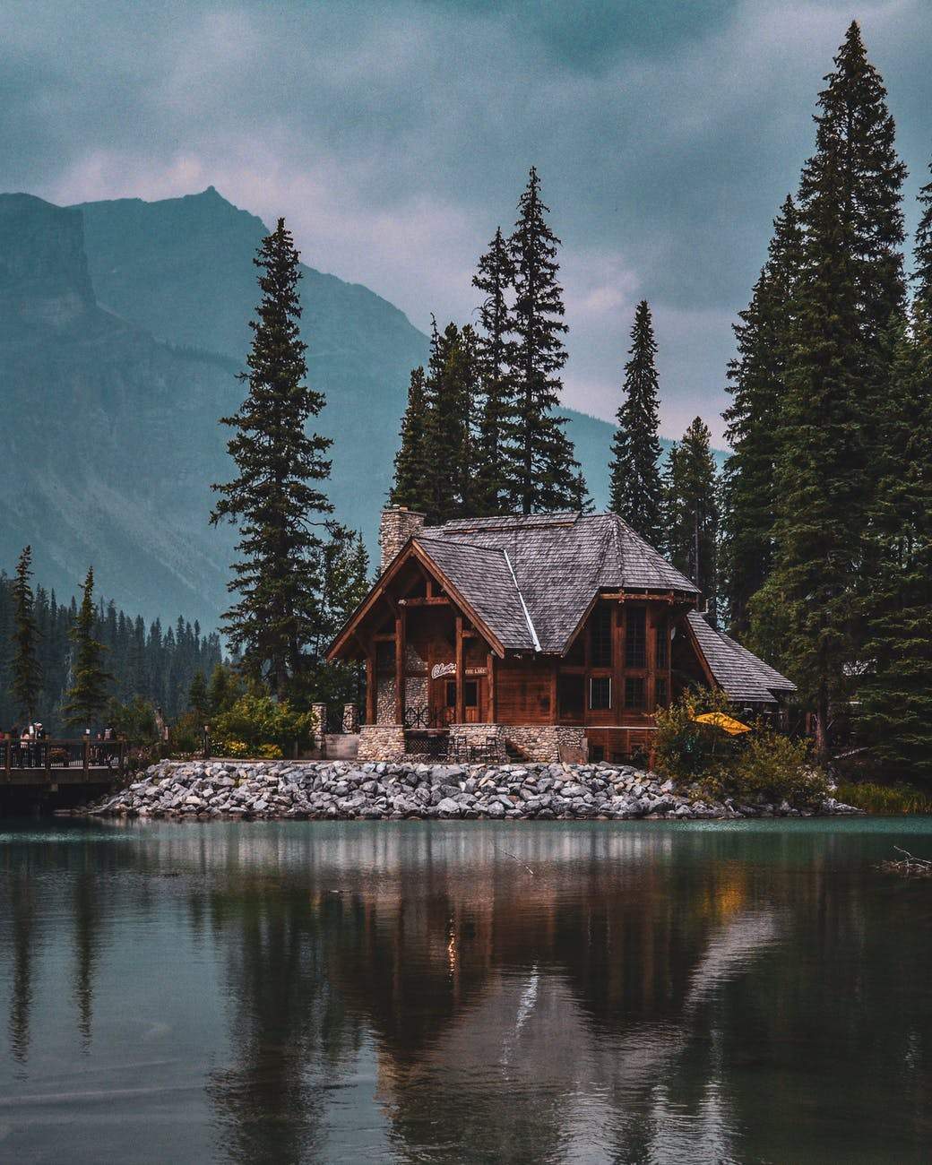 photo of wooden house near lake